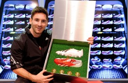 world famouse footballar Lionel Messi shows his shose