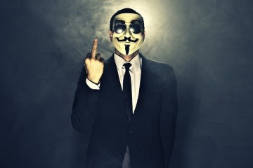 A man wearing mask shows middle finger