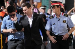 football superstar Lionel Messi with police man
