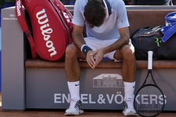 Roger Federer head down profile