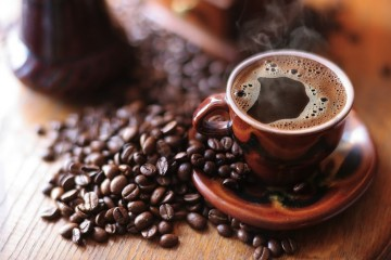 black coffee with coffee beans