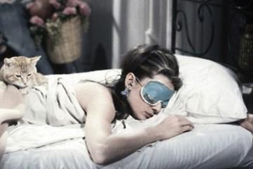 female deep sleep with cat
