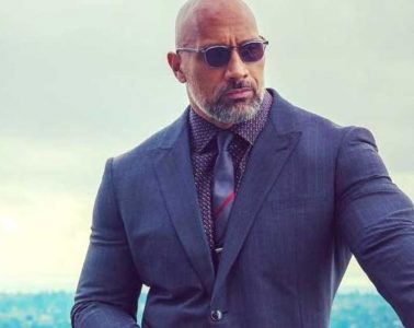 Dwayne The Rock Johnson in suit and sunglasses