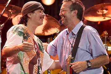 Carlos Santana Hugging Eric Clapton at Crossroads Guitar Festival 2004